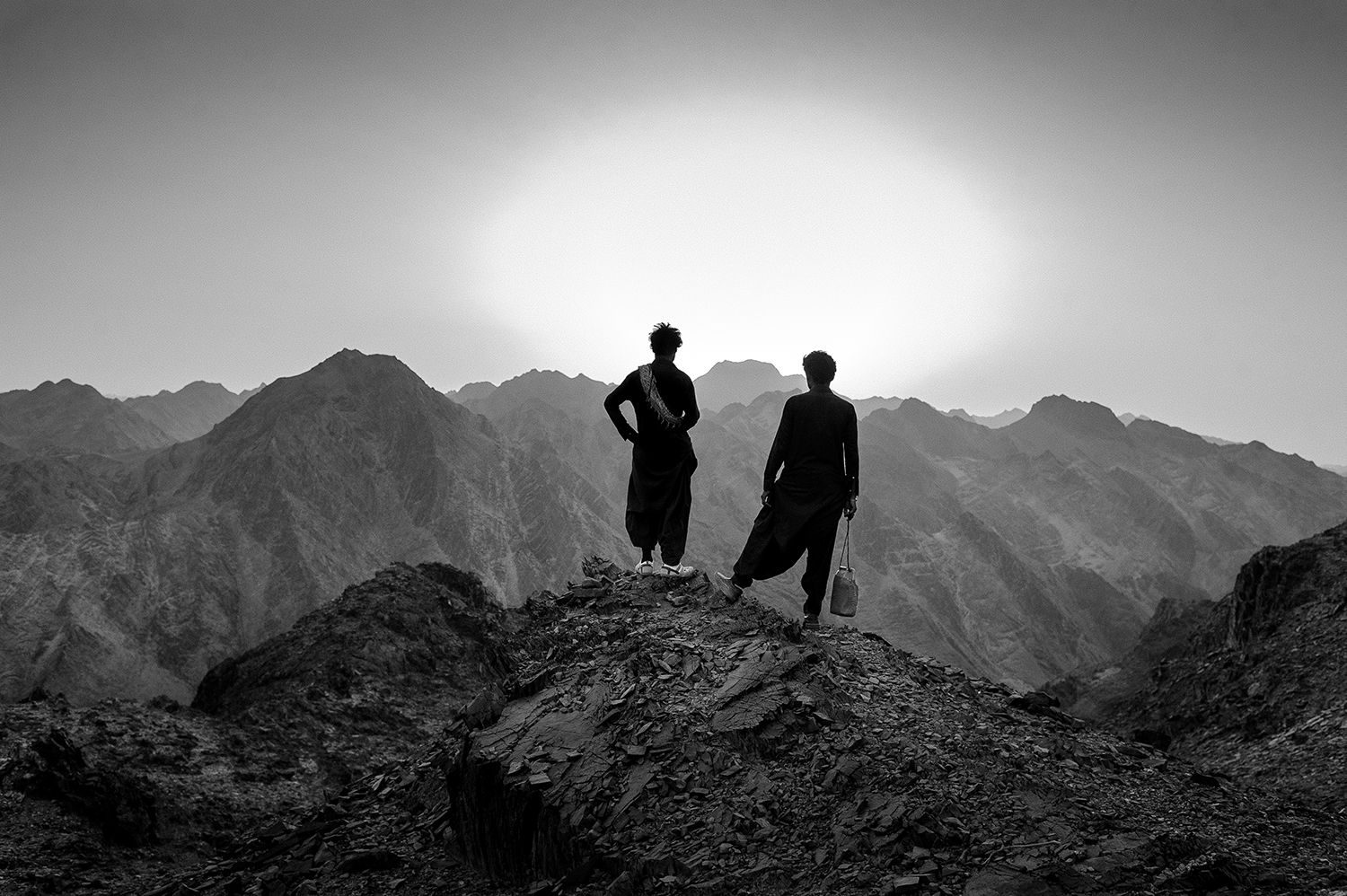 July 31, 2018  Iran, Sistan and Baluchistan province. Smugglers are checking the path and amount of darkness for getting ready to going down the mountains. Every few days they change time and their move path to hiding.  More than 5000 Afghan and Pakistani refugee try to pass the eastern Iranian border to go to a place far from their homeland. They will stay at Iran or will go to turkey and Greece.