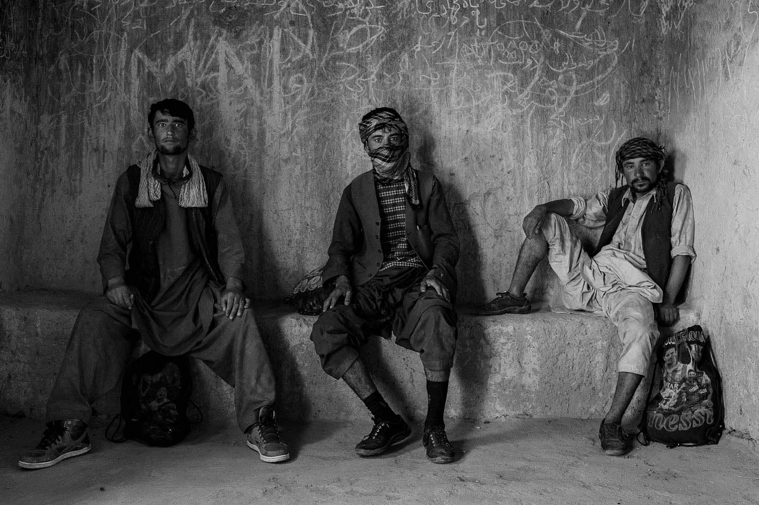 August 2017  Iran, Sistan and Baluchistan state, more than 5000 afghan and Pakistani refugee try to pass the eastern Iranian border to go to a place far from their homeland. Most of them will stay at Iran or will go to turkey and Greece.  Left side Farugh 22 yr Nikmuhammad 21 yr and Mohammad 25 yr in one the dormitories on their trip road. They are waiting order from their lord to move. They will almost meet 7 lords on their way and each of them is responsible for something in each city till they arrive the southern or western north border of Iran to exit.